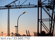 Germany, Bremerhaven - Loading cranes in the overseas port, behind container bridges, EUROGATE Container Terminal Bremerhaven. Редакционное фото, агентство Caro Photoagency / Фотобанк Лори