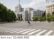 Купить «Derschprom on Freedom Square in the centre of Kharkiv, a building of Constructivism, first Soviet high-rise, built between 1925 and 1935 by Sergei Serafimov, Mark Felger and Samuil Krawez», фото № 33660950, снято 28 апреля 2019 г. (c) Caro Photoagency / Фотобанк Лори
