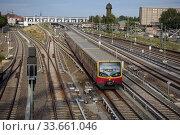 Berlin, Germany, view of the S-Bahn station Ostkreuz (2019 год). Редакционное фото, агентство Caro Photoagency / Фотобанк Лори