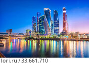 "Высотки ""Москва-Сити"". Moscow city skyscrapers and reflection in the Moscow river (2017 год). Стоковое фото, фотограф Baturina Yuliya / Фотобанк Лори"