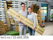 Купить «Couple buying wooden panels for homestead decoration», фото № 33665958, снято 3 июня 2020 г. (c) Яков Филимонов / Фотобанк Лори