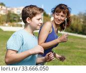 Купить «Mother and son running together», фото № 33666050, снято 11 ноября 2018 г. (c) Яков Филимонов / Фотобанк Лори