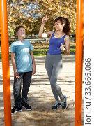 Купить «Family doing exercises on horizontal bar», фото № 33666066, снято 11 ноября 2018 г. (c) Яков Филимонов / Фотобанк Лори