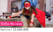 The words Flatten the curve with a Caucasian man and girl wearing capes during coronavirus covid19 p. Стоковое фото, агентство Wavebreak Media / Фотобанк Лори