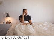 Sick Caucasian man self isolating and social distancing in quarantine lockdown during coronavirus co. Стоковое фото, агентство Wavebreak Media / Фотобанк Лори
