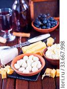 Купить «Cheese in bowl and on the board», фото № 33667998, снято 9 июля 2020 г. (c) age Fotostock / Фотобанк Лори