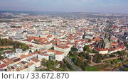 Купить «Autumn cityscape of Brno with famous gothic Cathedral of Saints Peter and Paul on sunny day, Czech Republic», видеоролик № 33672870, снято 15 октября 2019 г. (c) Яков Филимонов / Фотобанк Лори