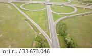 Купить «Panoramic aerial view of road junction in Russia from drone at sunny day», видеоролик № 33673046, снято 13 мая 2019 г. (c) Яков Филимонов / Фотобанк Лори