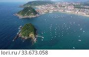 Купить «Aerial panoramic view of summer seascape with La Concha Bay and coastal city of San Sebastian, Basque Country, Spain», видеоролик № 33673058, снято 16 июля 2019 г. (c) Яков Филимонов / Фотобанк Лори