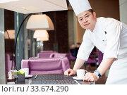 Купить «Young chinese chelf making dilicious food», фото № 33674290, снято 13 июля 2020 г. (c) age Fotostock / Фотобанк Лори