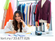Купить «Young adult fashion designer drawing and sketching her work at her atelier studio with colour palette as sole owner. Using for entrepreneur startup concept.», фото № 33677026, снято 11 июля 2020 г. (c) easy Fotostock / Фотобанк Лори