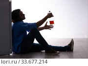 Купить «Young man suffering from alcoholism», фото № 33677214, снято 10 сентября 2019 г. (c) Elnur / Фотобанк Лори