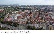 Купить «Aerial landscape of czech town of Pilsen with old historical houses in fall day», видеоролик № 33677422, снято 11 октября 2019 г. (c) Яков Филимонов / Фотобанк Лори