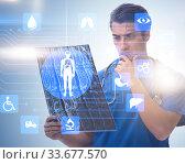 Купить «Doctor looking at x-ray image in telehealth concept», фото № 33677570, снято 4 июня 2020 г. (c) Elnur / Фотобанк Лори