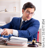 Young handsome judge working in court. Стоковое фото, фотограф Elnur / Фотобанк Лори