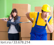 Купить «Woman boss and man contractor working with boxes delivery», фото № 33678214, снято 4 июня 2018 г. (c) Elnur / Фотобанк Лори