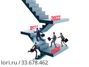Купить «Businessman climbing stairs on yearly basis», фото № 33678462, снято 12 мая 2020 г. (c) Elnur / Фотобанк Лори