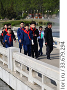 Купить «Pyongyang, North Korea. Pioneer team», фото № 33679294, снято 29 апреля 2019 г. (c) Знаменский Олег / Фотобанк Лори