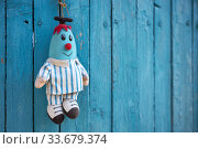 Купить «Faded soft doll in the shape of a blue man hangs on a blue wooden fence», фото № 33679374, снято 3 апреля 2020 г. (c) Олег Белов / Фотобанк Лори
