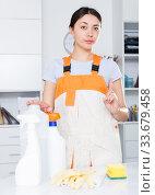Купить «Young woman wearing uniform cleaning at company office», фото № 33679458, снято 18 апреля 2018 г. (c) Яков Филимонов / Фотобанк Лори