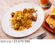 Купить «Braised sauerkraut with pork meat», фото № 33679586, снято 6 июня 2020 г. (c) Яков Филимонов / Фотобанк Лори