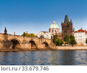 Купить «View of the Charles bridge over the Vltava river, the bridge tower and the church of St. Francis of Assisi in Prague. Czech Republic», фото № 33679746, снято 5 сентября 2014 г. (c) Наталья Волкова / Фотобанк Лори