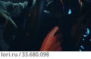 Купить «A young man sits in the car and turns the ignition key - neon lighting», видеоролик № 33680098, снято 25 мая 2020 г. (c) Константин Шишкин / Фотобанк Лори