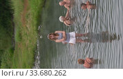 Vertical footage people take medicinal baths in public outdoor pool with natural thermal mineral water having balneological properties (2018 год). Редакционное видео, видеограф А. А. Пирагис / Фотобанк Лори