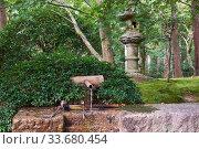 Купить «A ritual bamboo washbasin (tsukubai) at the entrance to the Ryoan-ji temple. Kyoto. Japan», фото № 33680454, снято 17 октября 2019 г. (c) Serg Zastavkin / Фотобанк Лори
