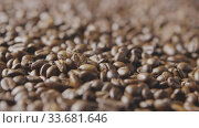 Macro video freshly roasted coffee beans fall on the grain. Slow motion, Full HD video, 240fps, 1080p. Стоковое видео, видеограф Ярослав Данильченко / Фотобанк Лори