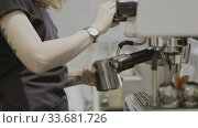 Купить «Young barista girl with tattoo whisks milk in a professional coffee machine. Slow motion, Full HD video, 240fps, 1080p.», видеоролик № 33681726, снято 14 марта 2019 г. (c) Ярослав Данильченко / Фотобанк Лори