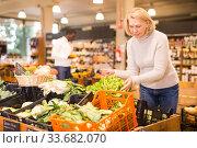 Купить «Woman choosing vegetables in food store», фото № 33682070, снято 14 ноября 2019 г. (c) Яков Филимонов / Фотобанк Лори