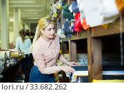 Купить «Woman choosing textiles in shop», фото № 33682262, снято 2 марта 2018 г. (c) Яков Филимонов / Фотобанк Лори