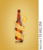 Купить «Beer bottle with water drops and spiral splash around bottle.», фото № 33682358, снято 7 февраля 2012 г. (c) Ярослав Данильченко / Фотобанк Лори