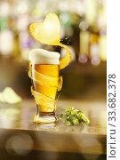 Купить «Flying heart splash of light beer above glass of fresh beverage.», фото № 33682378, снято 27 апреля 2017 г. (c) Ярослав Данильченко / Фотобанк Лори