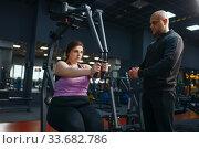 Купить «Overweight woman doing exercise in gym», фото № 33682786, снято 28 декабря 2019 г. (c) Tryapitsyn Sergiy / Фотобанк Лори