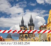Coronavirus in Prague, Czech Republic. The gothic Church of Mother of God in front of Tyn in Old Town Square. Covid-19 sign. Concept of COVID pandemic and travel in Europe. (2019 год). Стоковое фото, фотограф Владимир Журавлев / Фотобанк Лори