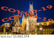 Coronavirus in Prague, Czech Republic. Mala Strana Bridge Tower at Charles Bridge. Covid-19 sign. Concept of COVID pandemic and travel in Europe. (2019 год). Стоковое фото, фотограф Владимир Журавлев / Фотобанк Лори