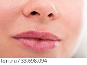 Купить «Close-up of woman's lips with natural lipstick make up. macro lipgloss make-up», фото № 33698094, снято 15 июня 2017 г. (c) Яков Филимонов / Фотобанк Лори