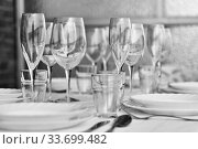Table settings with diverse glassware and tableware closeup. Стоковое фото, фотограф Alexander Tihonovs / Фотобанк Лори