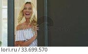 Купить «Caucasian woman opening the entrance door», видеоролик № 33699570, снято 19 февраля 2020 г. (c) Wavebreak Media / Фотобанк Лори