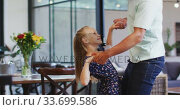 Купить «Father and daughter dancing together», видеоролик № 33699586, снято 19 февраля 2020 г. (c) Wavebreak Media / Фотобанк Лори
