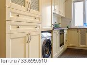 Купить «modern cream colored kitchen interior», фото № 33699610, снято 24 июля 2019 г. (c) Сергей Старуш / Фотобанк Лори