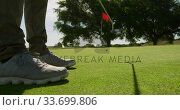 Купить «Golf player hitting the ball with his club», видеоролик № 33699806, снято 4 ноября 2019 г. (c) Wavebreak Media / Фотобанк Лори