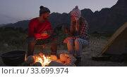 Caucasian couple camping in nature by night . Стоковое видео, агентство Wavebreak Media / Фотобанк Лори