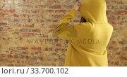 Купить «Back of Caucasian woman on a brick wall», видеоролик № 33700102, снято 23 июля 2019 г. (c) Wavebreak Media / Фотобанк Лори