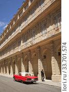 Купить «Vintage American car in front of the colonial buildings with balconies in Center Havana, La Habana, Cuba, West Indies, Central America», фото № 33701574, снято 17 апреля 2018 г. (c) age Fotostock / Фотобанк Лори