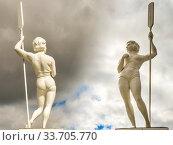 Купить «Скульптуры девушек с веслами на фоне неба», фото № 33705770, снято 10 июля 2020 г. (c) Сергеев Валерий / Фотобанк Лори