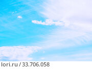 Купить «Dramatic blue sky background. Picturesque colorful clouds lit by sunlight. Vast sky landscape scene», фото № 33706058, снято 28 апреля 2018 г. (c) Зезелина Марина / Фотобанк Лори