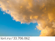 Купить «Sunset sky background. Picturesque golden colorful clouds lit by sunlight. Vast sky landscape panoramic scene», фото № 33706062, снято 25 мая 2019 г. (c) Зезелина Марина / Фотобанк Лори